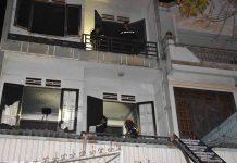 Tầng 2 của ngôi nhà nơi xảy ra vụ cháy. Ảnh: Hà Phương